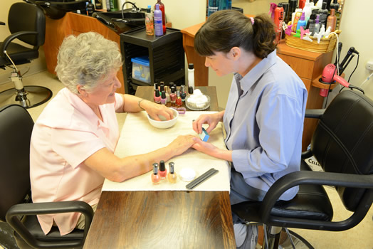 Resident getting nails done